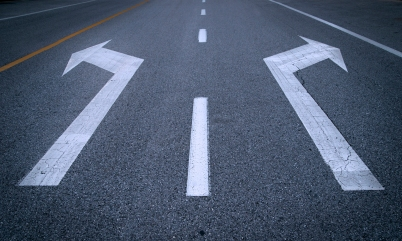 Arrow signs on asphalt