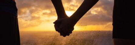romance-couple-holding-hands-by-water.jpg.1340x450_0_166_6978